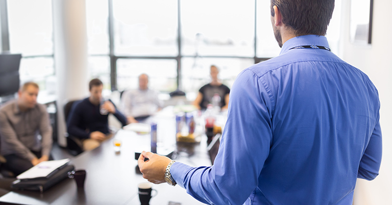 man giving presentation to group of people
